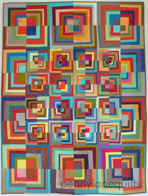 Hand dyed, improv log cabin quilt