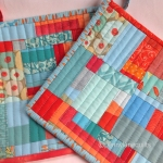 potholders, aqua and orange