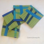 improv pieced green and blue coaster set