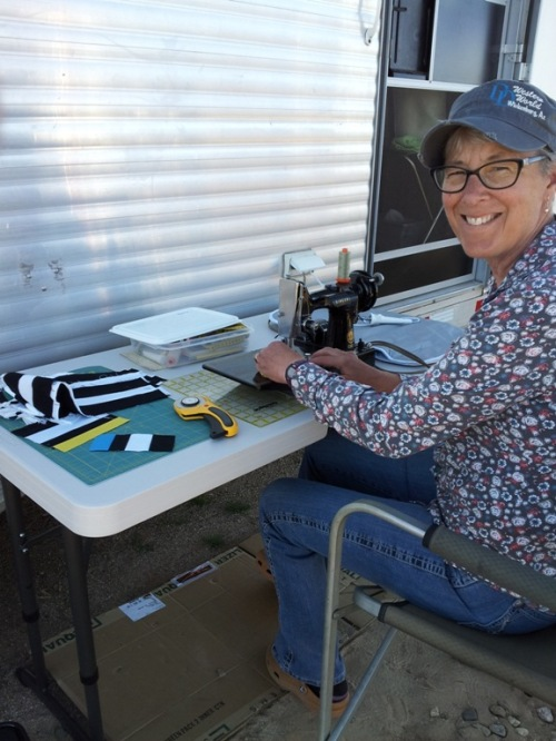 stitching on a featherweight outside of my horse trailer