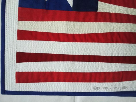 """dense machine quilting on the stripes of """"Made in America"""" , Marla Varner, penny lane quilts"""
