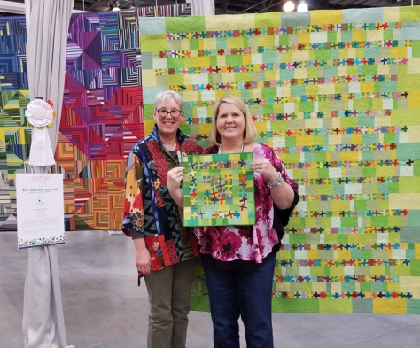Sandra Kaye with her two versions of Happy Dance, QuiltCon 2018 Pasadena