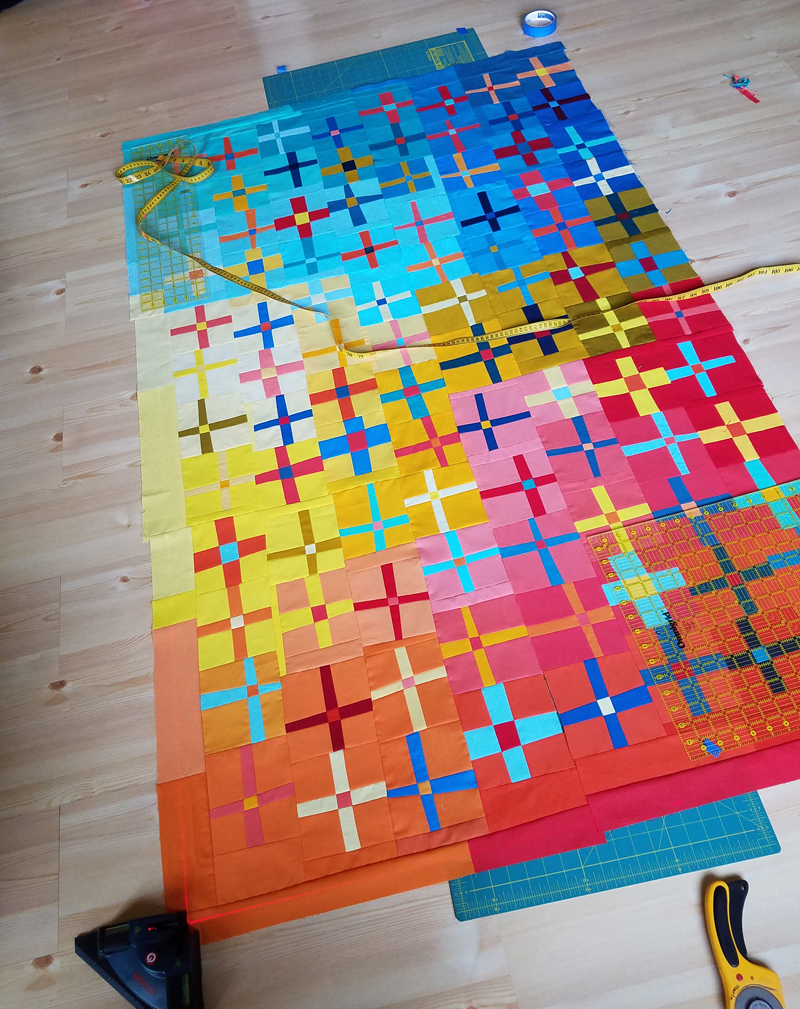 cutting the first long seam at the junction Marla Varner penny lane quilts