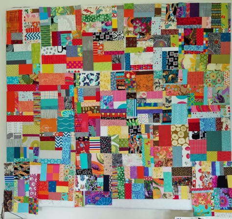 scrap vortex quilt on design wall