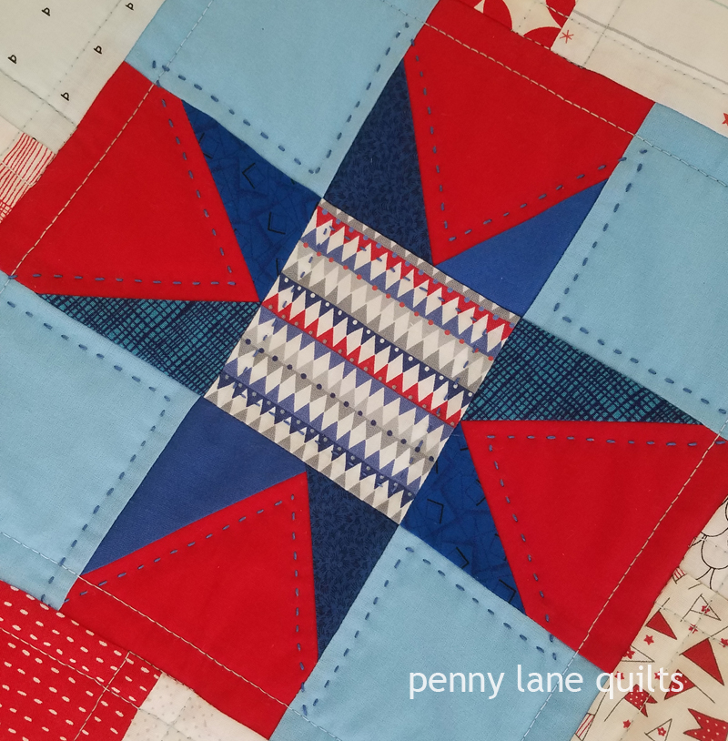 hand quilting around star on baby quilt